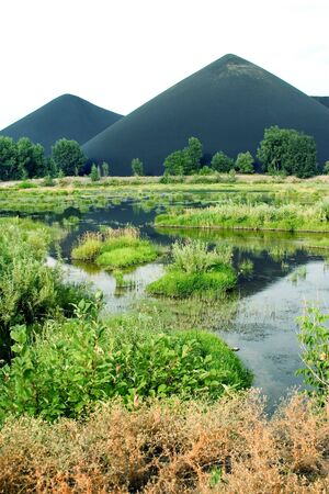 marsh and the black mountains of slags in Kazakhstan, Asia