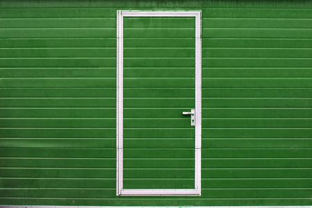 simple metal door in colored wall (different colors are available) Stock Photo - 4362531