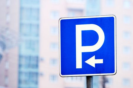 new blue park sign with arrow near residential area