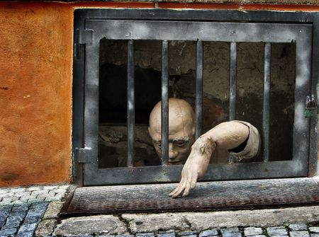 waiting convict: mannequin in jail for the tourists in Prague Stock Photo