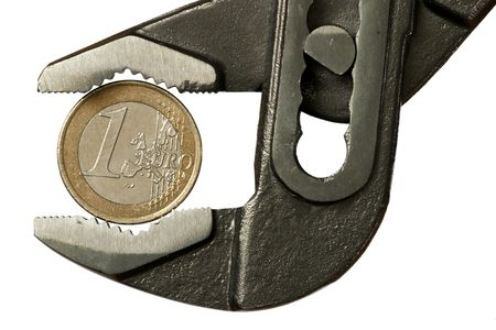 one Euro under pressure in adjustable spanner  Stock Photo