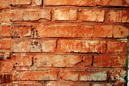 cyrillic: four russian names on brick wall Stock Photo