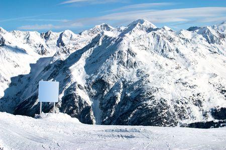 clear board in snowy Alps
