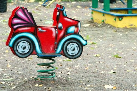 small child car on playground in autumn