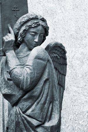 sculpture of angel with bible photo