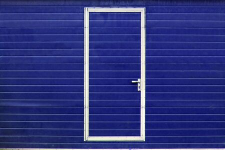 simple metal door in colored wall (different colors are available) Stock Photo - 4456959