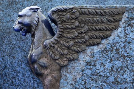 sculpture of griffin on embankment in Petersburg (sculptural ensemble of two sphinxes and four griffins) - blue colors