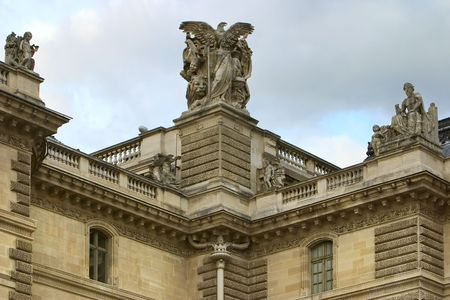 sculptures on roof of building