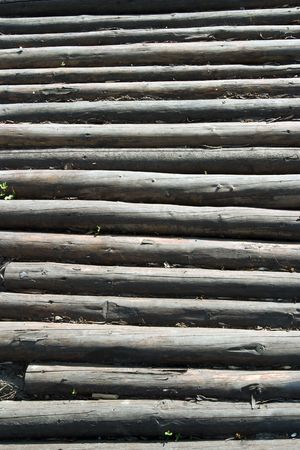 needless: old logs in village during sunny day