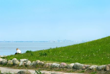 alone girl seating on sea coastline Stock Photo - 4496650