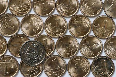 ukrainian coin with trident over layer of cheapest russian coins photo