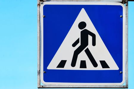 big road sign on pedestrian crossing photo