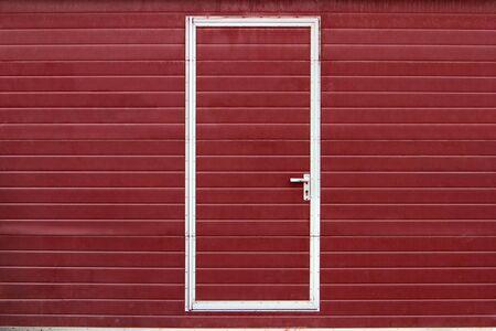 simple metal door in red wall Stock Photo - 4518144