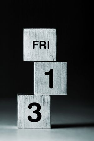 text FRI-13 on metal cubes (black background) Stock Photo