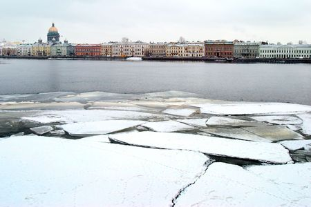 cracked ice on river Neva photo
