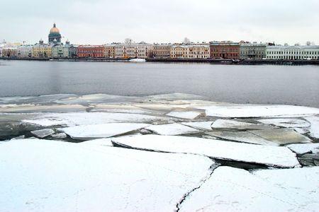 cracked ice on river Neva photo
