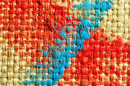 daubs: painted canvas (blue and red colors on rough surface) Stock Photo