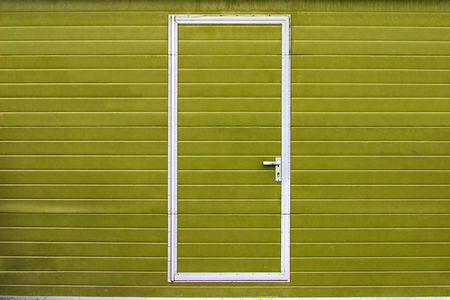 simple metal door in yellow wall Stock Photo - 4650030