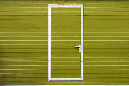simple metal door in yellow wall photo