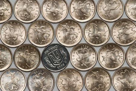ukrainian coin among russian coins photo