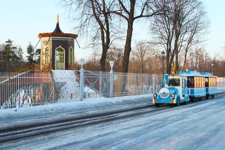 tourist train in the russian winter park (Ekaterinas park in St. Petersburg) photo