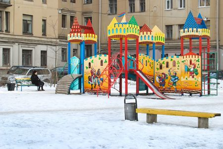 colorfull child castle on playground in urban yard photo