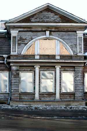 facade of old house with closed windows  Stock Photo