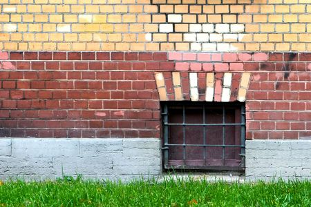 window in colored brick wall photo
