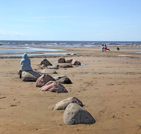 woman on desert coastline Stock Photo