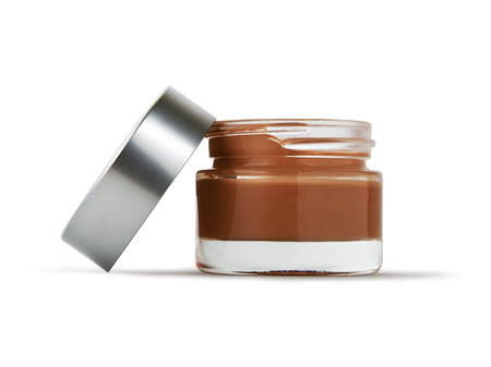 Open Cosmetic Cream Bottle on Isolated White Background. With clipping path