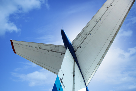 aluminum airplane: Details of the cargo and civilian aircraft. Best transport aircraft in the world. The tail of the plane.