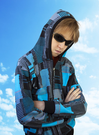 surly: Teenager in black glasses on isolated background