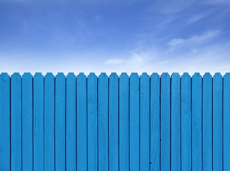 Fence wooden parallel bars, painted blue. Isolated on a white background.