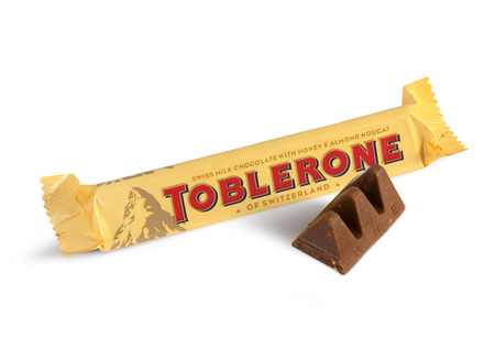 Chisinau, Moldova - June 14, 2016: A bar of Toblerone - Swiss milk chocolate with honey and almond nougat on a white background. With clipping path. Editorial