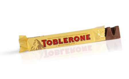 toblerone: Chisinau, Moldova - June 14, 2016: A bar of Toblerone - Swiss milk chocolate with honey and almond nougat on a white background. With clipping path. Editorial