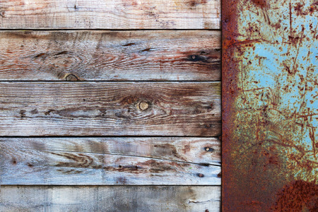adboard: Wooden Wall with a Old Blank Metal Rusty Placard