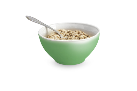 Oatmeal or dry cereal in a green bowl