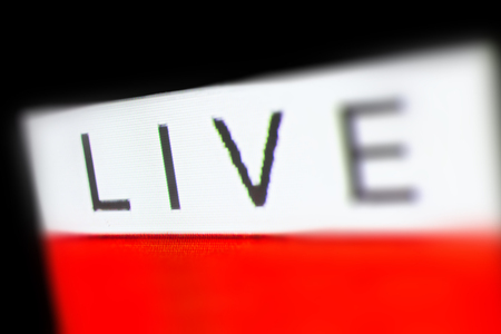 Live Lettering on white Background, Macro Photography of Television Screen Editorial