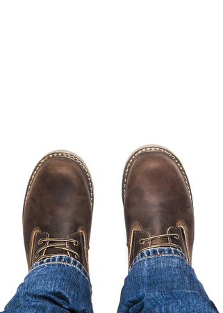 Mens brown boots and blue jeans isolated Banque d'images