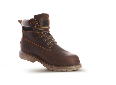 Man ankle boots, brown color, with nubuck leather. Isolated on white background, closed up