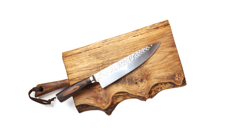 Knife for kitchen on old wooden cutting Board Stock Photo