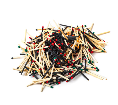 A lot of matches are mixed, of different color, isolated on white background Reklamní fotografie - 124902218