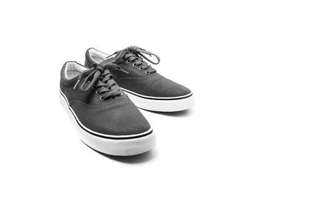 A pair of black canvas shoes isolated on white