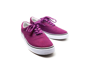 A pair of Pink canvas shoes isolated on white