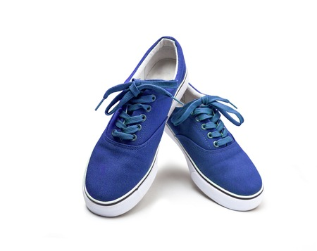 A pair of blue color canvas shoes isolated on white background with clipping path Stockfoto