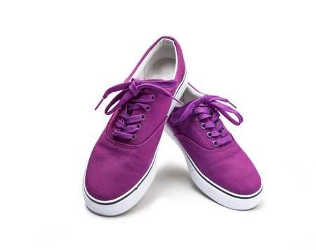 A pair of pink color canvas shoes isolated on white background with clipping path