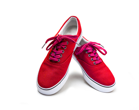 A pair of red color canvas shoes isolated on white background with clipping path