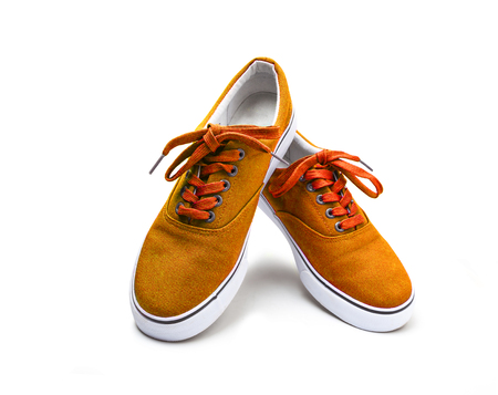 A pair of orange color canvas shoes isolated on white background with clipping path