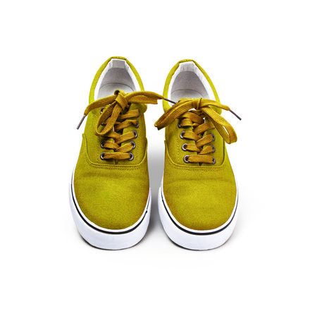 A pair of Yellow canvas shoes isolated on white background with clipping path
