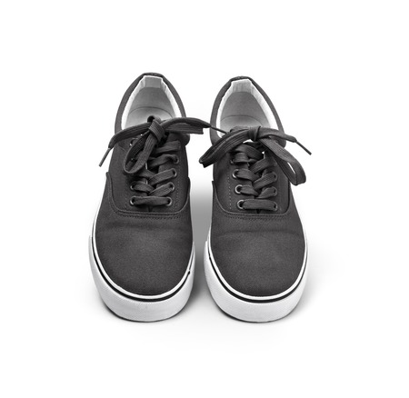A pair of black canvas shoes isolated on white background with clipping path